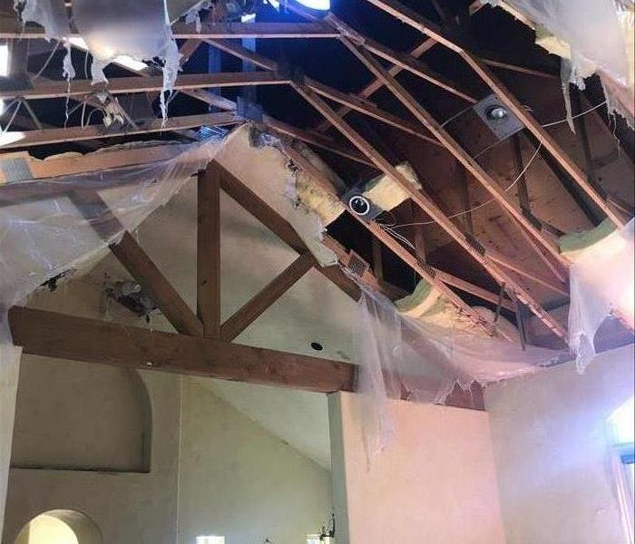 Ceiling has fallen showing the bare beams.