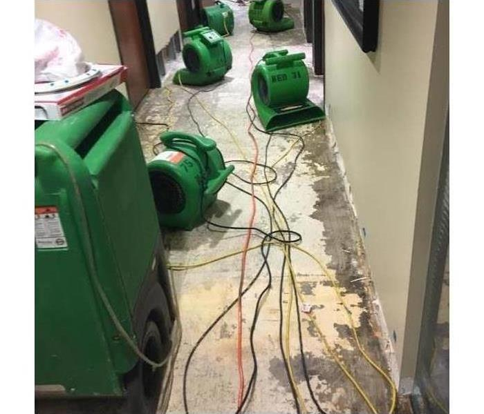 Air movers placed in a hallway. Drying equipment.